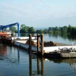 Evacuation par barge fluviale de déchets industriels pour retraitement